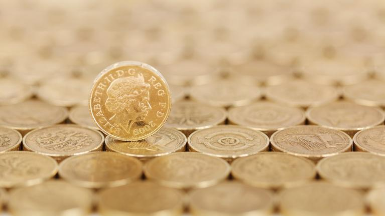 Table surface covered in pound coins